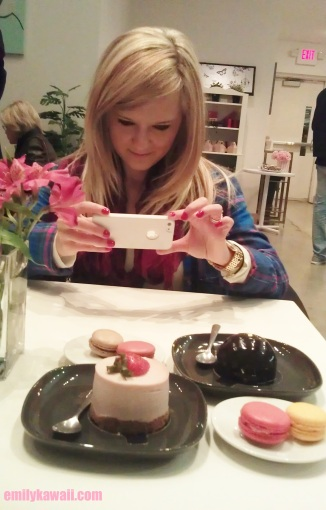 Ely taking pictures of our desserts